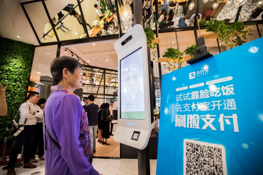 "A customer tries Alipay's facial recognition payment solution ""Smile to Pay"" at KFC's new KPRO restaurant in Hangzhou, Zhejiang province, China September 1, 2017.  REUTERS/Stringer"