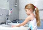 15960327 - little girl washing in bathroom