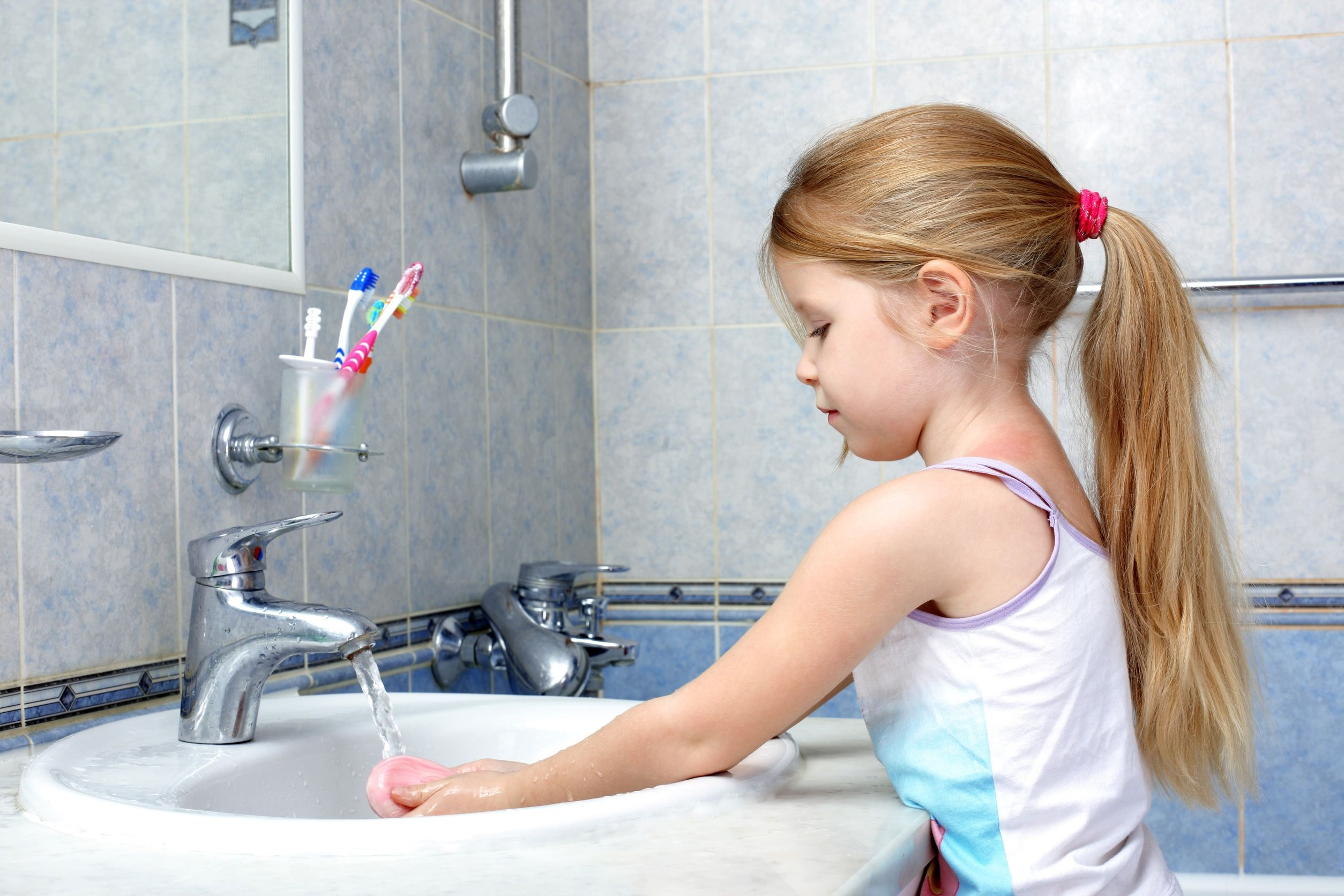15960327 - little girl washing in bathroom